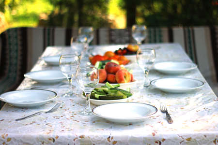 wingalsses and plates on a settle table outdoor Banco de Imagens - 62676015