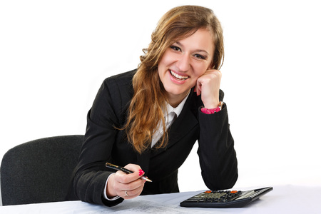 deposit slip: woman thinks on the calculator .In a hand holding a pen