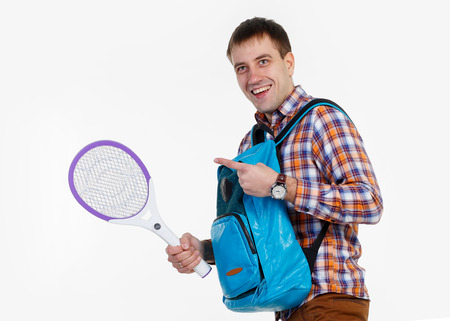 fetishes: A man with a racket against mosquitoes