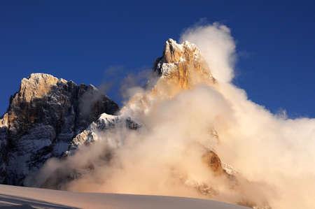 Mount Cimon della Pala, Pale di San Martino mountain group in the fog, Dolomites mountains - Italy, Europe.