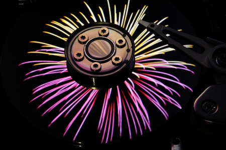 hard disk: Close up of Computer Hard Disc Drives with color fireworks effects reflected on the disk surface. Background wallpaper. Stock Photo