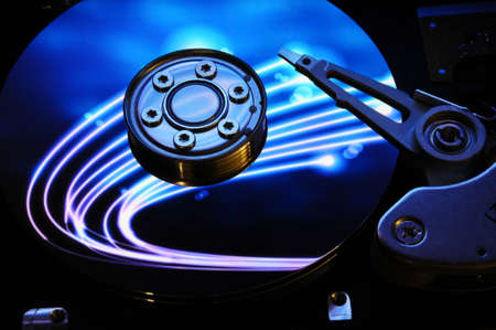Close up of Computer Hard Drive Disc with colors reflected on the disk surface. Background wallpaper. 写真素材