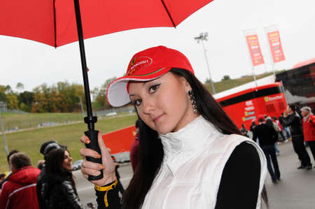 babe: MUGELLO, IT, November, 2011: Unidentified Pit Babe poses for photos in the paddock During Ferrari World Finals 2011 at the Mugello Circuit in Italy