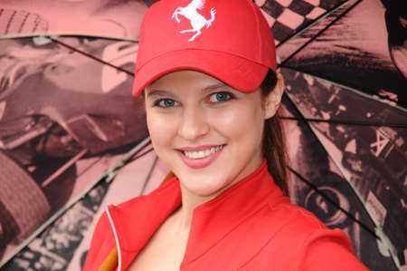 MUGELLO, IT, November, 2011: Unidentified Pit Babe poses for photos in the paddock During Ferrari World Finals 2011 at the Mugello Circuit in Italy
