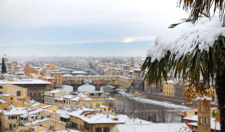 The famous Old Bridge in Florence with snow, Italy.
