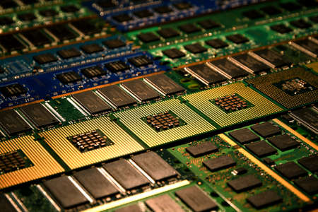 Computer processors and ram modules aligned as background.