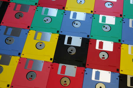 diskette: Multicolored floppy disk 3.5 for old computers. Aligned as background.