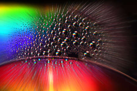 DVD and CD disc with water drops over and colorful effects Stock Photo