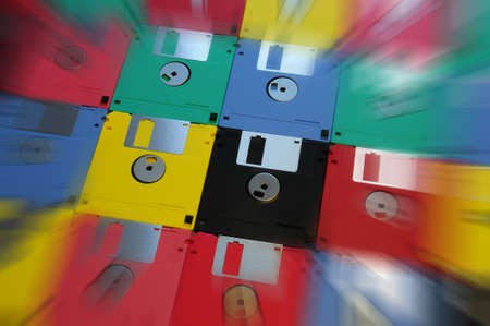 Multicolored floppy disk 3.5 for old computers. background.