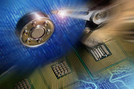 Computer processors with Open Hard Disk Drive and binary blue light effects postproduction, background. Stock Photo