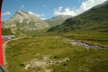rack mount: Switzerland: July 2012, Swiss Mountain Train Bernina Express from Tirano to St. Moritz Editorial