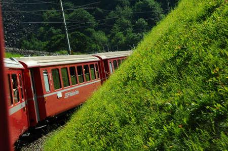 rack mount: Switzerland: July 2012, Swiss Mountain Train Bernina Express from Tirano to St. Moritz - unesco heritage Editorial