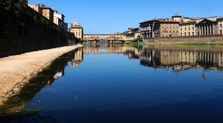 15 August 2017: Panoramic view of Old Bridge (Ponte Vecchio) with blue sky in Florence, Italy.
