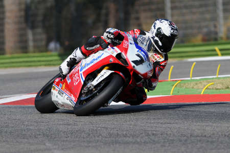 imola: San Marino, Italy - Sep 24, 2011: Ducati 1198R of Althea Racing, driven by Carlos Checa in action during the Superbike Practice in Imola Circuit, Italy Editorial