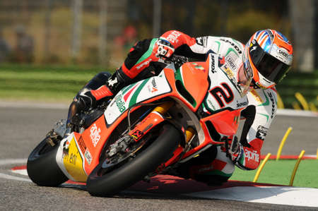 San Marino, Italy - Sep 24, 2011: Aprilia RSV4 Factory - Aprilia Alitalia Racing Team  driven by Leon Camier GBR in action during the Superbike Practice in Imola Circuit, Italy