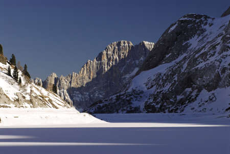 Lake Fedaia with Civetta group on the background, Dolomites, Val di Fassa - Italy.