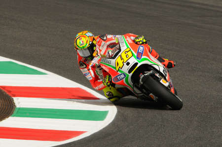 MUGELLO - ITALY, JULY 13 2012: Italian Ducati rider Valentino Rossi during 2012 TIM MotoGP GP of Italy. Imagens
