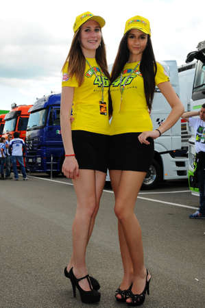 MUGELLO, IT, May 2014: Unidentified Pit Babes poses for photos in the paddock during MotoGP GP of Italy at the Mugello Circuit in Italy Editorial