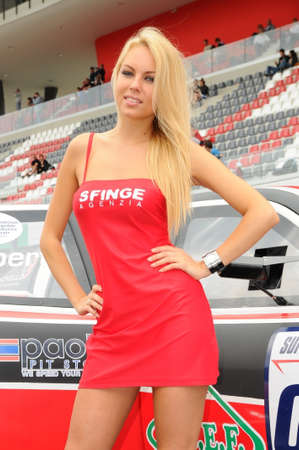 MUGELLO, IT, May 2012: Beautiful Unidentified Pit Babes poses for the paddock during Superstars Championship at the Mugello Circuit in Italy