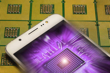 Smartphone on Aligned Computer Processors CPU with electronic circuit inside effects.
