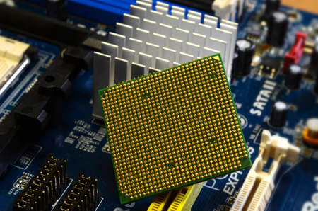 Close up of CPU Processor over Computer Motherboard. Tecnology background. Stock Photo