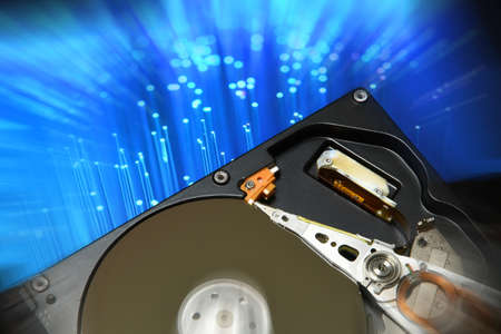 Close Up of Open Hard Disk Drive over colored background. Stock Photo