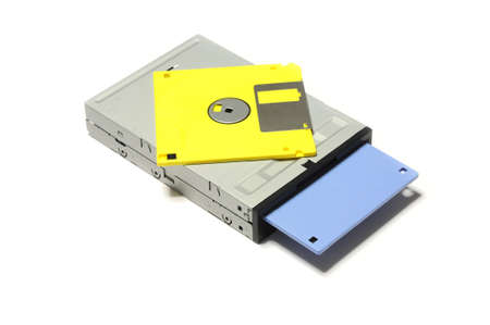 old computer floppy diskette inside floppy drive isolated on white background