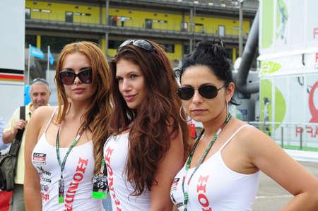 MUGELLO - JUNE 2010: Grid girls at 2010 TIM GP of Italy MotoGP on June 2010 in Mugello Circuit in ITALY. Redakční