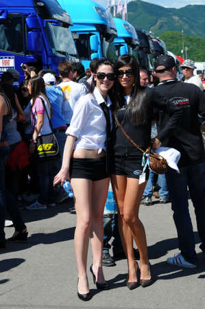 MUGELLO - MAY 2009: Grid girls in the paddock of 2009 TIM GP of Italy MotoGP on May 2009 at Mugello Circuit in ITALY. Redactioneel