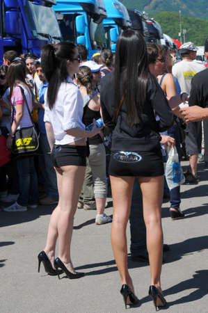 MUGELLO - MAY 2009: Grid girls in the paddock of 2009 TIM GP of Italy MotoGP on May 2009 at Mugello Circuit in ITALY. 新闻类图片