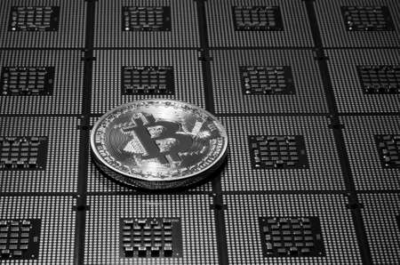 closeup of phosical bitcoin over computer cpu processors aligned. background and concept image. bn image