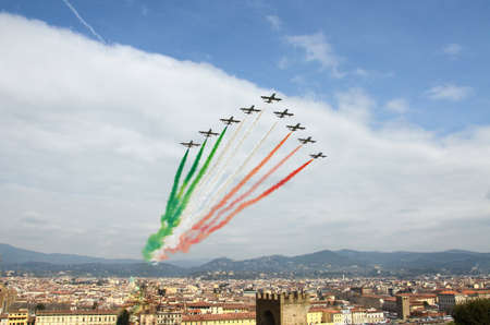 Florence, Italy - March, 28 2018: Airshow of PAN Frecce Tricolori. The Frecce Tricolori in the sky of Florence for 95th birthday of the Italian Air Force in Florence. The team flies the Aermacchi MB-339-APAN.