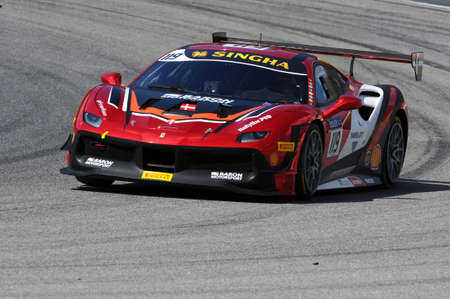 MUGELLO, ITALY - 23 March 2018: Per Nielsen drive Ferrari 488 Challenge during practice session of Round #1 of Ferrari Challenge at Mugello Circuit in Italy.