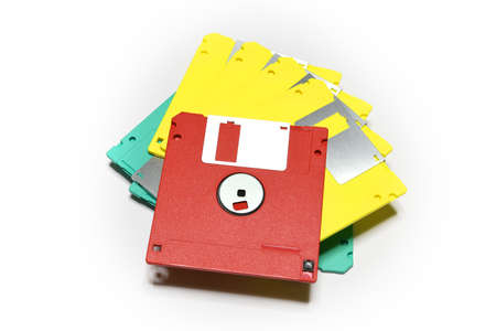 old colored computer floppy disks isolated on white Stock Photo