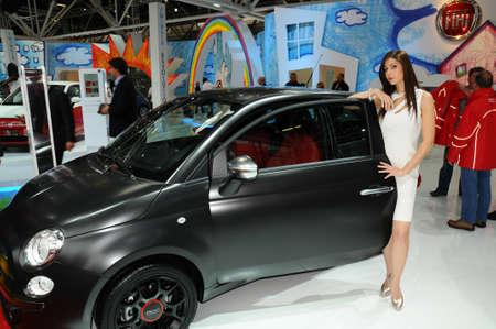BOLOGNA, ITALY - DECEMBER 2, 2010: beautiful hostess poses at ABARTH Stand at the Bologna Motor Show. Italy