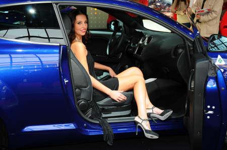 BOLOGNA, ITALY - DECEMBER 2, 2010: beautiful hostess poses at Alfa Romeo Stand at the Bologna Motor Show. Italy