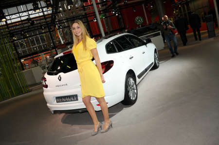 BOLOGNA, ITALY - DECEMBER 2, 2010: beautiful fashion model poses at the Bologna Motor Show. Italy