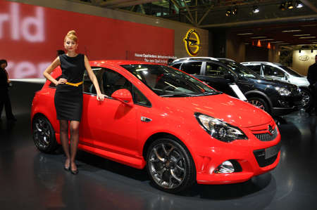 BOLOGNA, ITALY - DECEMBER 2, 2010: beautiful hostess poses at OPEL Stand at the Bologna Motor Show. Italy