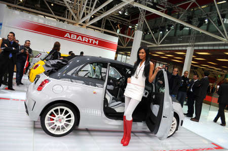 BOLOGNA, ITALY - DECEMBER 2, 2010: beautiful hostess poses at ABARTH Stand at the Bologna Motor Show. Italy