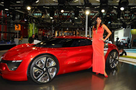 BOLOGNA, ITALY - DECEMBER 2, 2010: beautiful fashion model poses with Renault Dezir Concept at the Bologna Motor Show. Italy