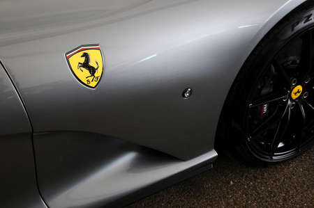 Scarperia (Florence), Italy - March 2018 : Ferrari Logo on Sport Car in the paddock of Mugello Circuit. Ferrari S.P.A. is an Italian luxury sports car manufacturer, founded by Enzo Ferrari.
