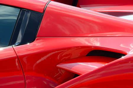 Scarperia (Florence), Italy - March 2018: Detail of a Ferrari sports car in the Mugello Paddock. Ferrari SPA is an Italian luxury sports car manufacturer, founded by Enzo Ferrari.