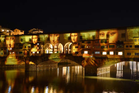 Italy, Florence, December 2018: La Gioconda by Leonardo da Vinci projected on the Ponte Vecchio in Florence, in occasion of F-Light - Festival of Lights, during Christmas season. italy