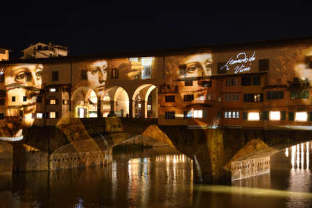 Italy, Florence, December 2018: The famous Ponte Vecchio of Florence illuminated in the occasion of the F-Light - Festival of Lights with the masterpieces of Leonardo da Vinci during the Christmas season.