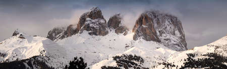 Winter landscape of Sasso Along mountain group (Lang Kofel) in the Italian Dolomites. Sassolungo or Langkofel is the highest mountain of the Langkofel Group in the Dolomites in Italy.
