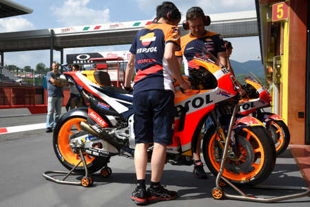 MUGELLO - ITALY, 2 JUNE: Mechanics work on the Honda RC213V 2018 of Repsol Honda Team - in the Pit Lane at 2018 GP of Italy in Mugello Circuit. Italy.