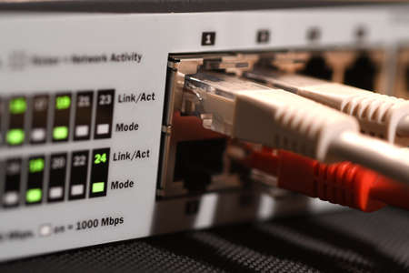 Detail of RJ45 Lan Cables and lights on network switches. Macro Shot Banque d'images