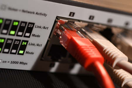 Detail of RJ45 Lan Cables and lights on network switches. Macro Shot