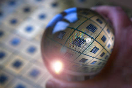 Detail of Computer CPU Chip reflected in to a crystal lensball. abstract background. tecnology background.