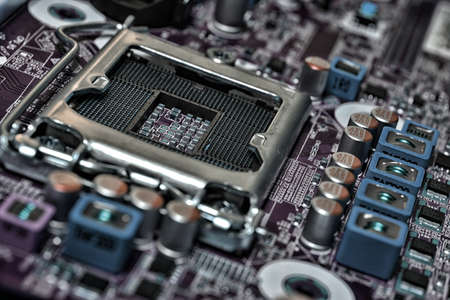 Detail of cpu socket on a modern computer motherboard. Electronic small component details.